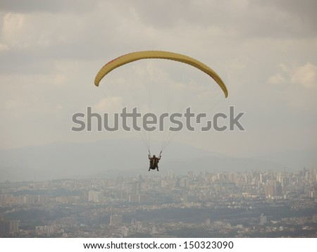 Paragliding over the gray city