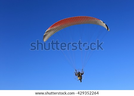Paragliding over the sea - stock photo