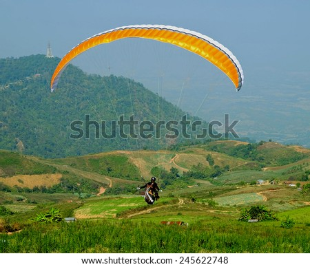 Paragliding sport - stock photo