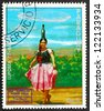 PARAGUAY - CIRCA 1977: a stamp printed in Paraguay shows Indian Girl in Bottle Dance Costume, Graf Zeppelin 1st South America Flight, circa 1977 - stock photo