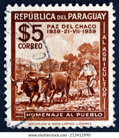 PARAGUAY - CIRCA 1940: a stamp printed in Paraguay shows Plowing, circa 1940 - stock photo