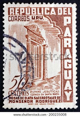 PARAGUAY - CIRCA 1955: a stamp printed in Paraguay shows Santa Maria Cornice, Jesuit Ruins, circa 1955 - stock photo