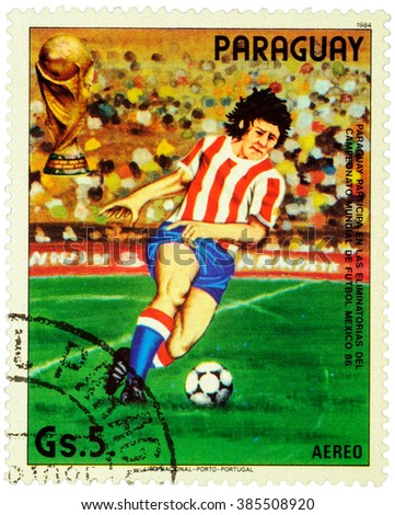 PARAGUAY - CIRCA 1984: stamp printed in Paraguay shows running football player, devoted to the Football World Cup in Mexico 1986, series, circa 1984 - stock photo