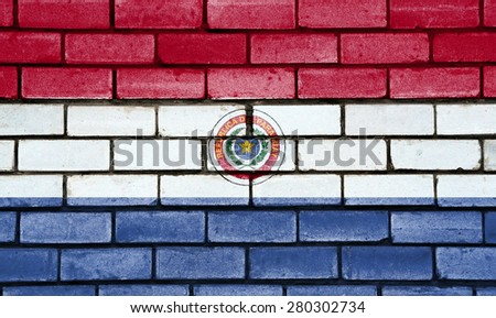 Paraguay flag painted on old brick wall texture background - stock photo