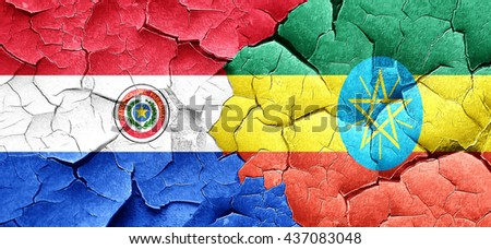 Paraguay flag with Ethiopia flag on a grunge cracked wall - stock photo