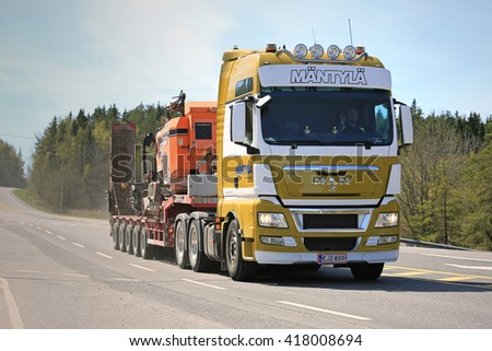 PARAINEN, FINLAND - MAY 6, 2016: MAN TGX 32.540 semi transports Tamrock 282 Rock Drill along highway in Southwest Finland at spring. - stock photo