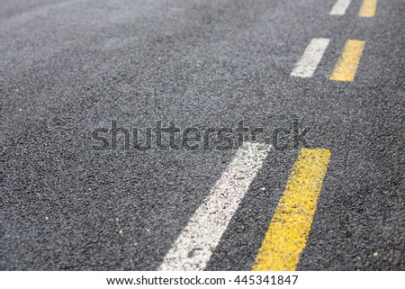 Parallel road lines in white and yellow