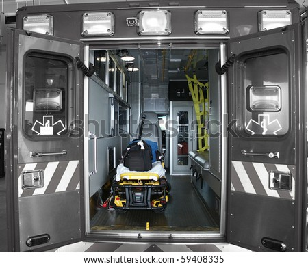 Paramedic's truck with open doors (parts of the image desaturated for stronger effect.) - stock photo