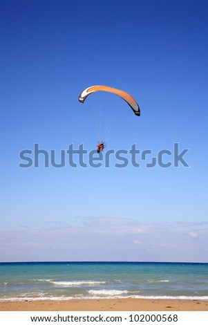 paramotor glider flying in the air