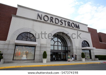 PARAMUS - JULY 9: Shoppers walk past a Nordstrom department store in Paramus, New Jersey, on Tuesday, July 9, 2013. Nordstrom is a major clothing retailer. - stock photo