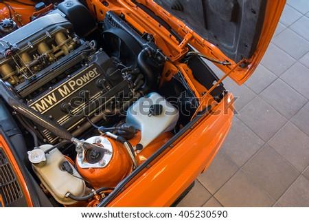 Paramus,NJ - April 7 2016: At a free local car show, M Power plant of a vintage orange M3 coupe. - stock photo
