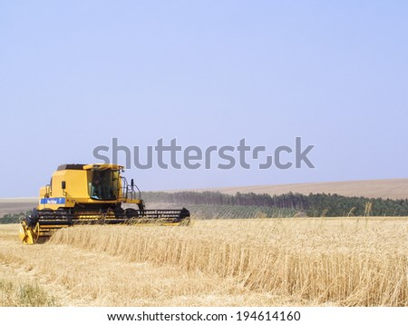 PARANA, BRAZIL, SEPTEMBER 20, 2007.  Combine harvester on a wheat field - stock photo