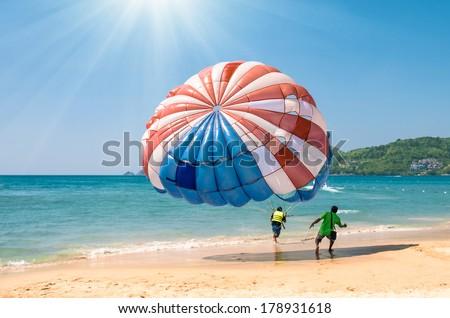 Parasailing at Patong Beach in Phuket - Thailand extreme Sports - stock photo