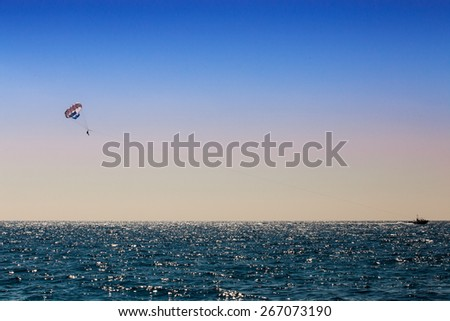 parasailing man over the sea  - stock photo