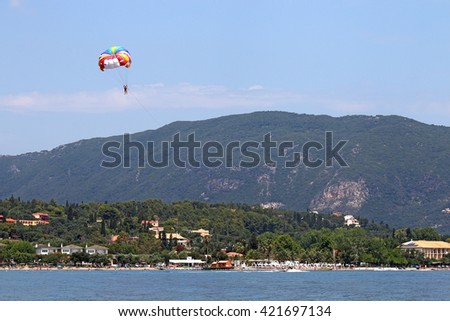 parasailing on blue sky Corfu island summer season - stock photo
