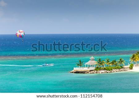 Parasailing on the Caribbean Sea in Ocho Rios, Jamaica - stock photo