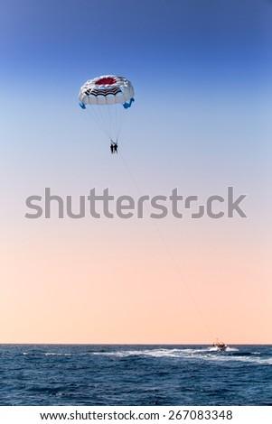 parasailing over blue sea  - stock photo