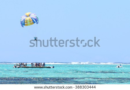 Parasailing over Indian Ocean near Mauritius Island. - stock photo