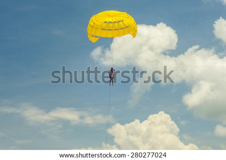 Parasailing over the blue waters of the Andaman Sea