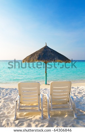 Parasol and chaise lounges , Maldives - stock photo