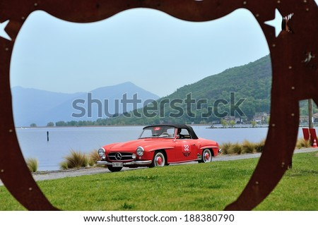 PARATICO, ITALY - APRIL 12: A red Mercedes-Benz 190SL takes part to the Franciacorta Historic classic car race on April 12, 2014 in Paratico. This car was built in 1955.  - stock photo