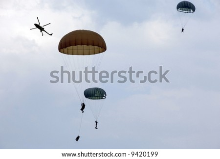 Paratroopers down from the helicopter to the battlefield - stock photo