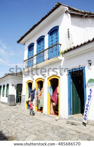 PARATY, BRAZIL - MARCH 28, 2013: A narrow cobbled stoned street in the old colonial town Paraty, Brazil.