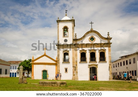 PARATY, RIO DE JANEIRO, BRAZIL - JAN 17, 2016: tourists walking in front of church and museum. Paraty is a colonial and historic city in Rio de Janeiro. - stock photo