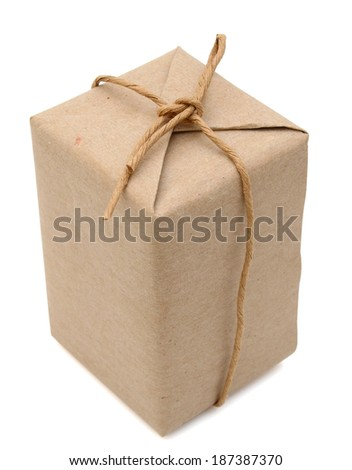 parcel box wrapped with brown paper - stock photo