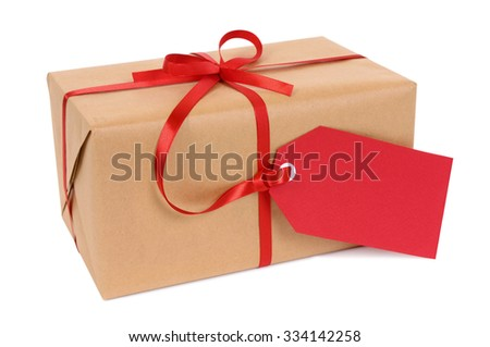Parcel or gift with red gift tag isolated on white background - stock photo