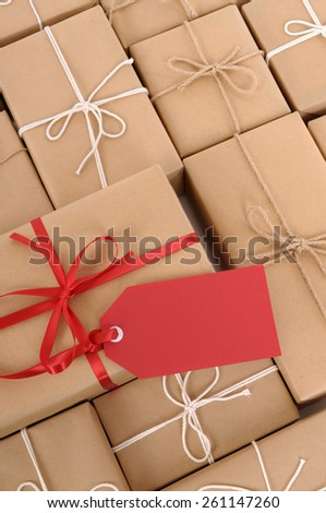 Parcel pile, heap, label, red gift tag vertical - stock photo