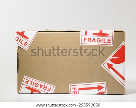 parcel with the fragile sticker - stock photo