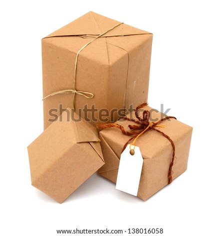 parcel wrapped box with brown kraft paper, on shopping - stock photo