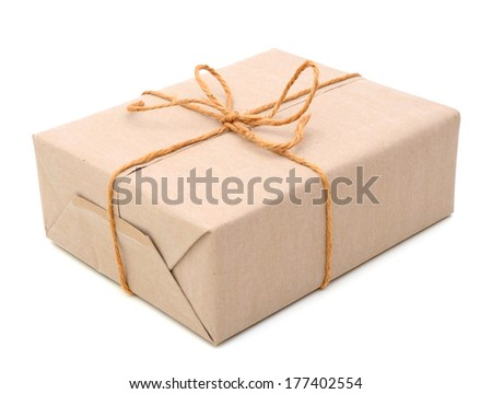 Parcel wrapped in brown paper - stock photo