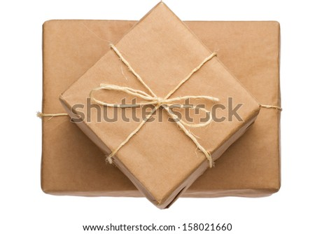 Parcel wrapped in brown paper and tied with rough twine - stock photo