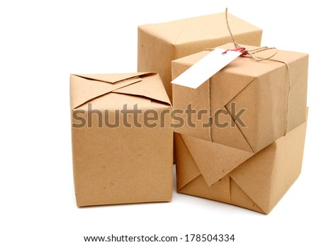 Parcel wrapped with brown kraft paper, on duty - stock photo