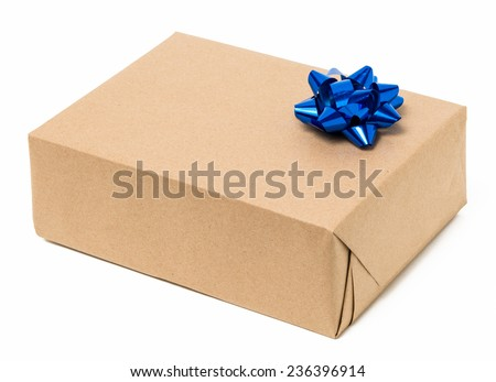 Parcel wrapped with brown kraft paper with a  blue bow - stock photo