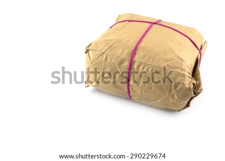 Parcel wrapped with brown paper, tied with pink string isolated on white background prepare to send
