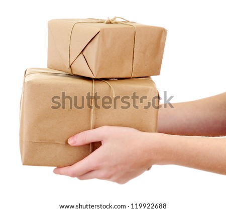 parcels boxes in woman hands, isolated on white - stock photo