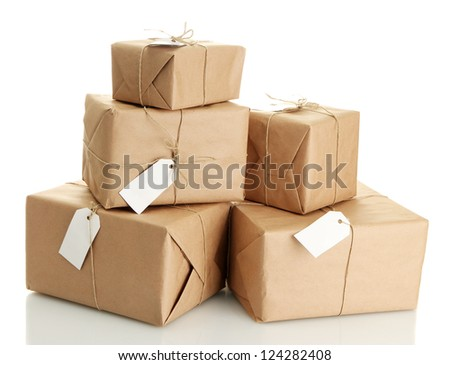 parcels boxes with kraft paper, isolated on white - stock photo