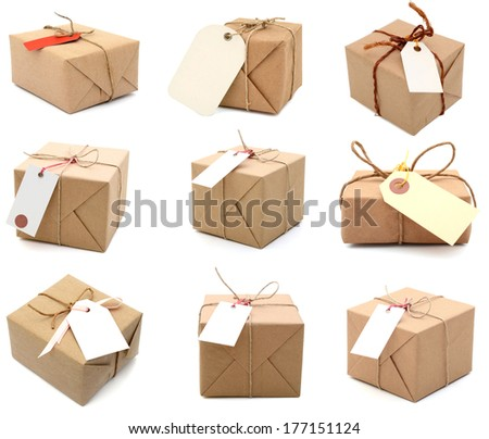 Parcels with blank tags, isolated on white  - stock photo