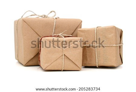 Parcels wrapped in brown paper and tied with rough twine - stock photo