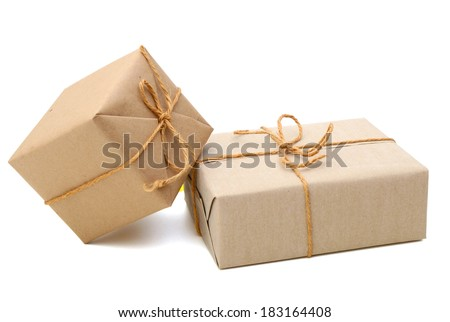 parcels wrapped with brown paper and tied with string. Isolated on white background  - stock photo
