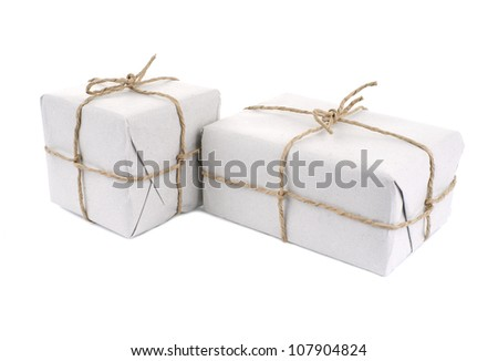 Parcels wrapped with  paper, tied with string, isolated on white