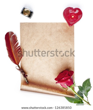 parchment, a quill, a rose, a candle and ink on a white background - stock photo