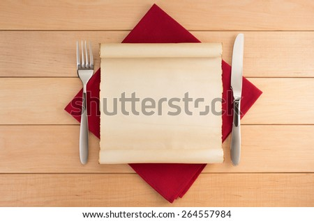parchment and napkin on wooden background - stock photo