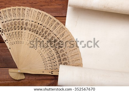 Parchment for your text with a female fan. - stock photo