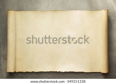 parchment scroll on old background - stock photo