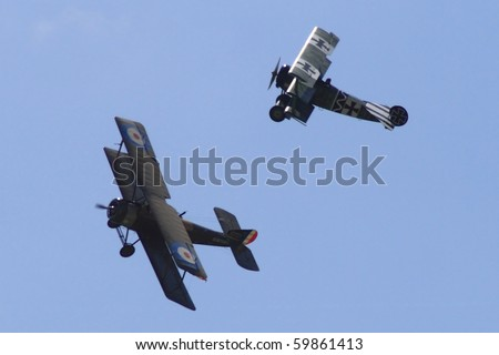 PARDUBICE,CZECH REPUBLIC - JUNE 5:two historical planes demonstrate dog fight during 100 years of aviation airshow on June 5, 2010 in Pardubice, Czech Republic
