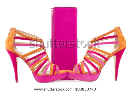 Pare of pink and orange shoes and a matching bag, isolated on white background - stock photo